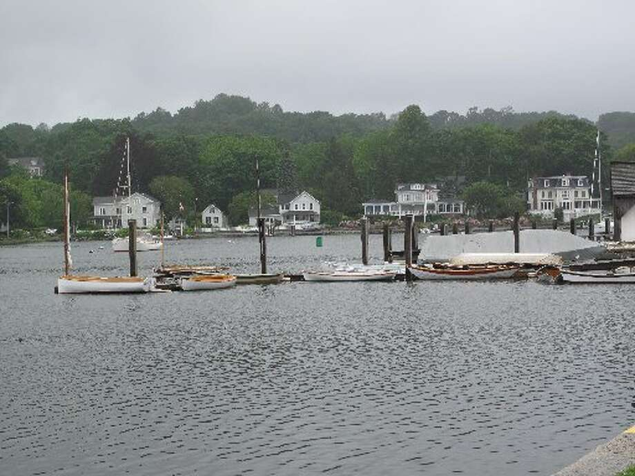 Small boats line the dock in Mystic, Conn.