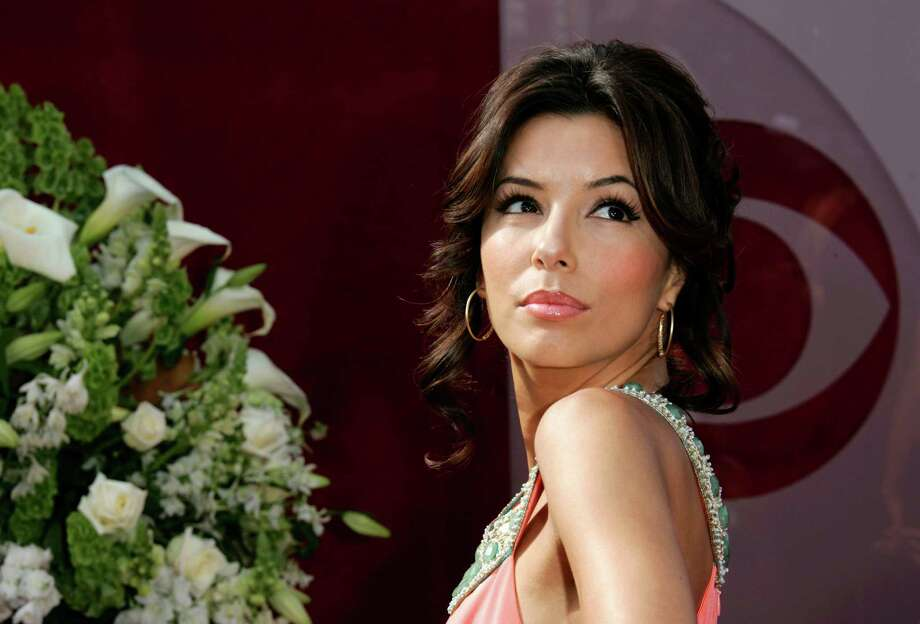 "Eva Longoria, from television series ""Desperate Housewives,"" arrives for the 57th Annual Primetime Emmy Awards Sunday, Sept. 18, 2005, at the Shrine Auditorium in Los Angeles. (AP Photo/Kevork Djansezian) Photo: KEVORK DJANSEZIAN, AP / AP"