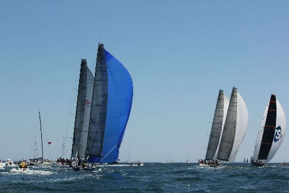 Sailboats compete in the Newport-Bermuda race off the coast of Newport, R.I.