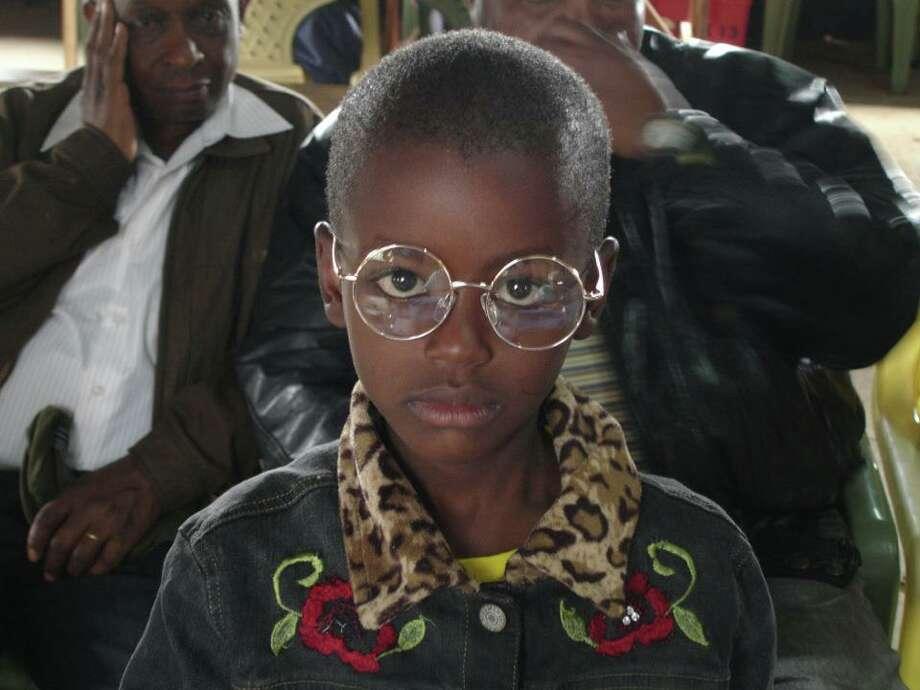 A young girl receives glasses for the first time in Oloitokitok, Kenya (Photo: Brenda Davis)