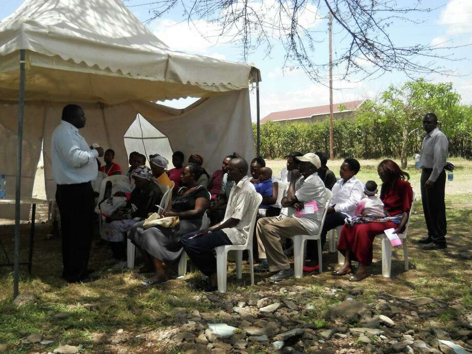 Kenya evangelists share the Gospel with people coming to the eye-glass clinics (Photo: Pam Epperly)