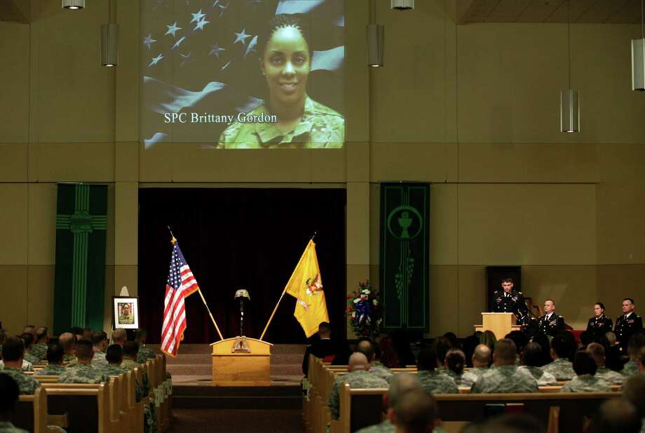 A photo of U.S. Army Spc. Brittany Gordon is projected on a wall, Wednesday, Nov. 14, 2012, during a memorial service at Joint Base Lewis McChord, Wash. Gordon was killed in Afghanistan on Oct. 13, 2012, when officials say an Afghan intelligence officer detonated the suicide vest he was wearing while Gordon and other soldiers were delivering furniture to an intelligence office. Photo: Ted S. Warren / Associated Press