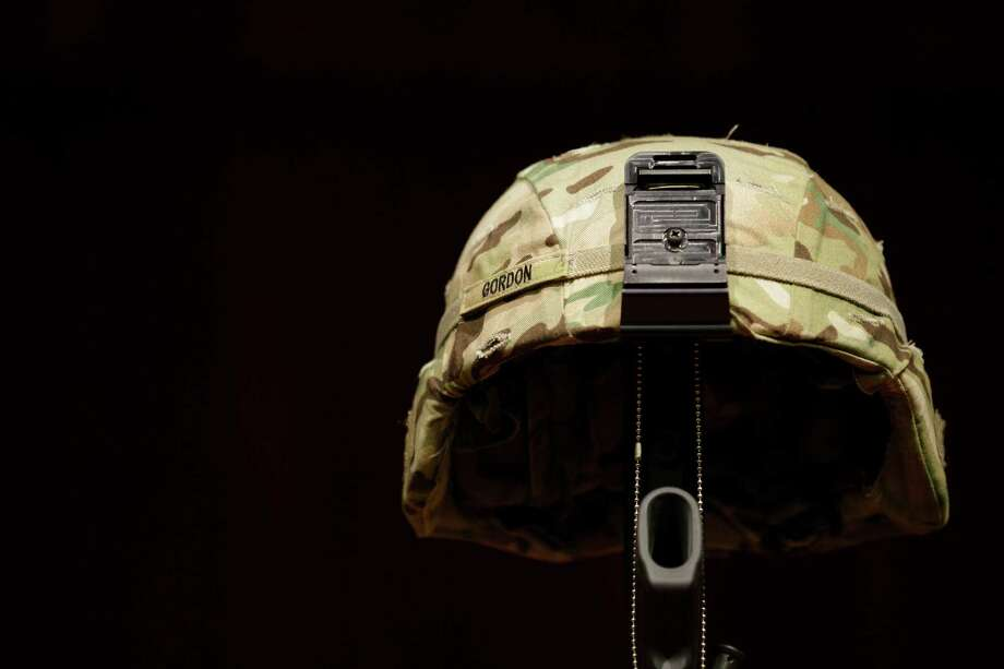 A helmet belonging to U.S. Army Spc. Brittany Gordon is displayed at a memorial service, Wednesday, Nov. 14, 2012, at Joint Base Lewis McChord, Wash. Gordon was killed in Afghanistan on Oct. 13, 2012, when officials say an Afghan intelligence officer detonated the suicide vest he was wearing while Gordon and other soldiers were delivering furniture to an intelligence office. Photo: Ted S. Warren / Associated Press