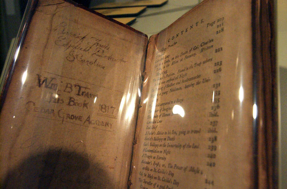 William B. Travis childhood poetry book on display at the Long Barracks Museum at the Alamo Tuesday, October 4, 2005. GLORIA FERNIZ/STAFF Photo: GLORIA FERNIZ, SAN ANTONIO EXPRESS-NEWS / SAN ANTONIO EXPRESS-NEWS