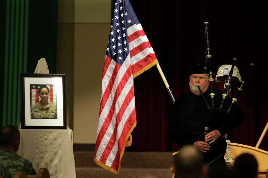 "Bagpiper Seamus Neary plays ""Amazing Grace"" at a memorial service for U.S. Army Spc. Brittany Gordon, shown in the photo at left, Wednesday, Nov. 14, 2012, at Joint Base Lewis McChord, Wash. Gordon was killed in Afghanistan on Oct. 13, 2012, when officials say an Afghan intelligence officer detonated the suicide vest he was wearing while Gordon and other soldiers were delivering furniture to an intelligence office. Photo: Ted S. Warren / Associated Press"