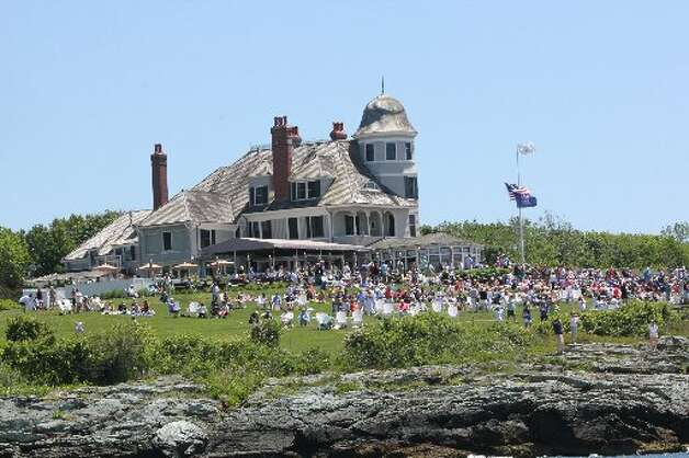 A crowd gathers on the lawn in Newport, R.I. to watch the sailboats compete in the Newport-Bermuda race last summer.