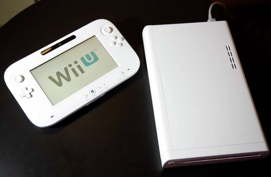 The new WiiU console is seen at the 2012 International CES tradeshow, Tuesday, Jan. 10, 2012, in Las Vegas.  (AP Photo/Julie Jacobson) Photo: Julie Jacobson, Associated Press / AP