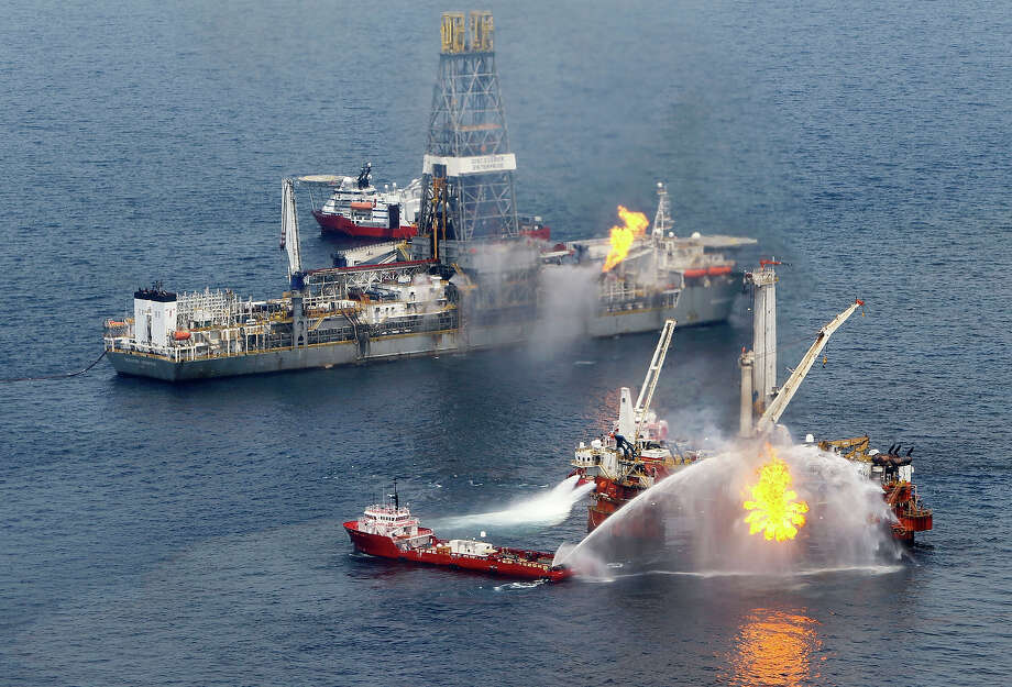 A rig burns oil and gas near the Discoverer Enterprise (L) at the site of the Deepwater Horizon oil spill on June 19, 2010 in the Gulf of Mexico.  The BP oil spill has been called one of the largest environmental disasters in American history. Photo: Pool, Getty Images / 2010 Getty Images