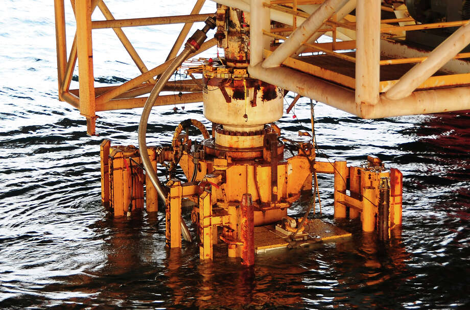 GULF OF MEXICO - SEPTEMBER 4: (EDITORS NOTE: Image has been released by U.S. Military prior to transmission.)  In this handout image provided by the U.S. Coast Guard, the damaged blow out preventer along with the Lower Marine Riser Package (LMRP) cap from the Deepwater Horizon oil rig that caused the massive oil spill is extracted and put aboard the vessel Q4000 on September 4, 2010 in the Gulf of Mexico.  The 50-foot, 300-ton preventer was removed and replaced on the well head by a newly tested preventer and will be taken for evidence to a NASA facility in Louisiana in the ongoing investigation with the Deepwater Horizon Criminal Investigation Team and FBI Evidence Recovery Team. Photo: U.S. Coast Guard, Getty Images / 2010 U.S. Coast Guard