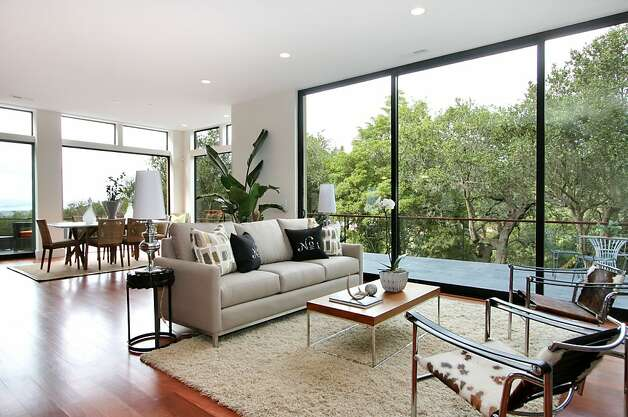 The home includes numerous floor-to-ceiling windows. Photo: Liz Rusby