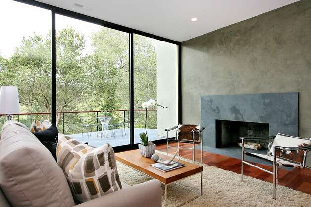 The living room has a fireplace. Photo: Liz Rusby