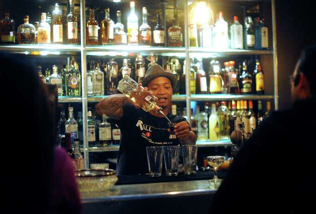 Omar Yeefoon mixes a cocktail at The Brooklynite to raise money for Hurricane Sandy relief efforts. Photo: Billy Calzada, San Antonio Express-News / © 2012 San Antonio Express-News