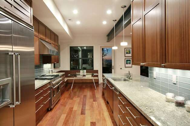 Another view of the home's kitchen, which includes a breakfast nook. Photo: Liz Rusby