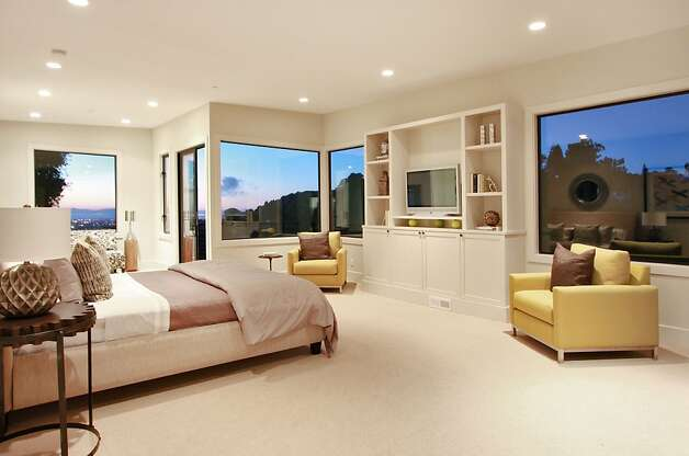The master suite features a walk-in closet, built-in media center and a private balcony. Photo: Liz Rusby
