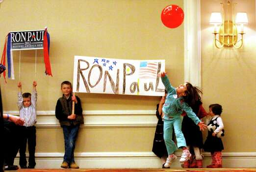 Young supporters of Texas Republican Ron Paul wait for Paul to arrive for a town hall meeting in Denver, Tuesday, Jan. 31, 2012. Photo: Jack Dempsey, Associated Press / FR42408 AP