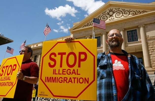 Showdown day at the Supreme Court over the Arizona immigration law. (AP photo) (The Associated Press)