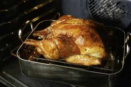 Roasted turkey in the oven as seen in San Francisco, California on Wednesday, August 22, 2012. Styling by Lauren N. Reuthinger.