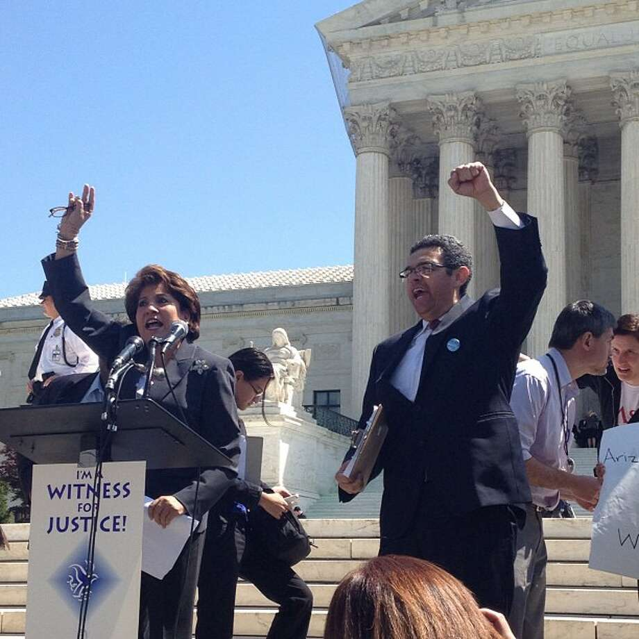 Clarissa Martinez, director of immigration for the National Council of La Raza, leads the crowd outside the Supreme Court in a chant against the Arizona law. (Emily Wilkins/Houston Chronicle) (Emily Wilkins/Houston Chronicle)