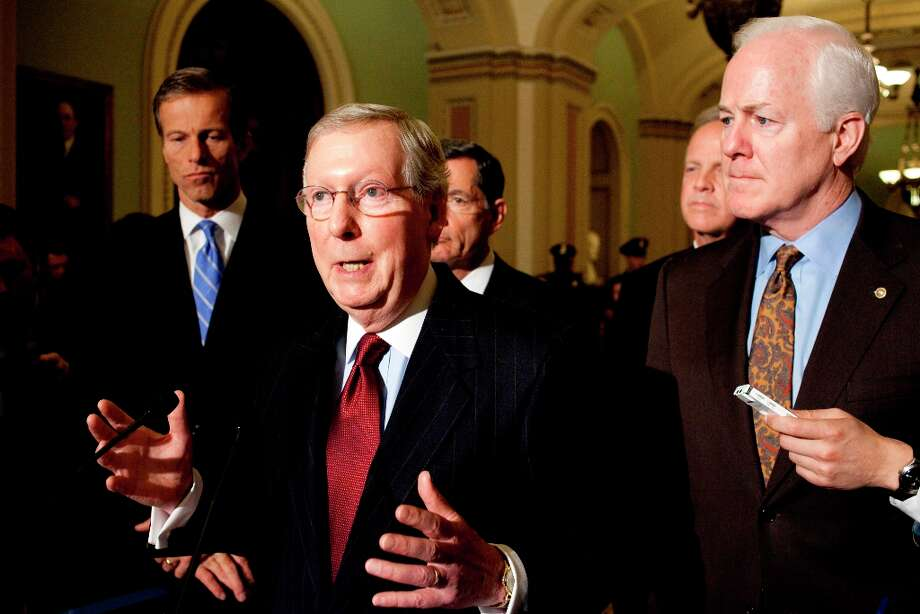 Senate Minority Leader Mitch McConnell of Ky., center, gesture during a news conference on Capitol Hill in Washington, Wednesday, Nov. 14, 2012. From left are, Sen. John Thune, R-S.D., McConnell, Sen. John Barrasso, R-Wyo., Jerry Moran, R-Kansas, and new Senate Minority Whip John Cornyn of Texas. (AP Photo/Harry Hamburg) Photo: Harry Hamburg, Associated Press / FR170004 AP