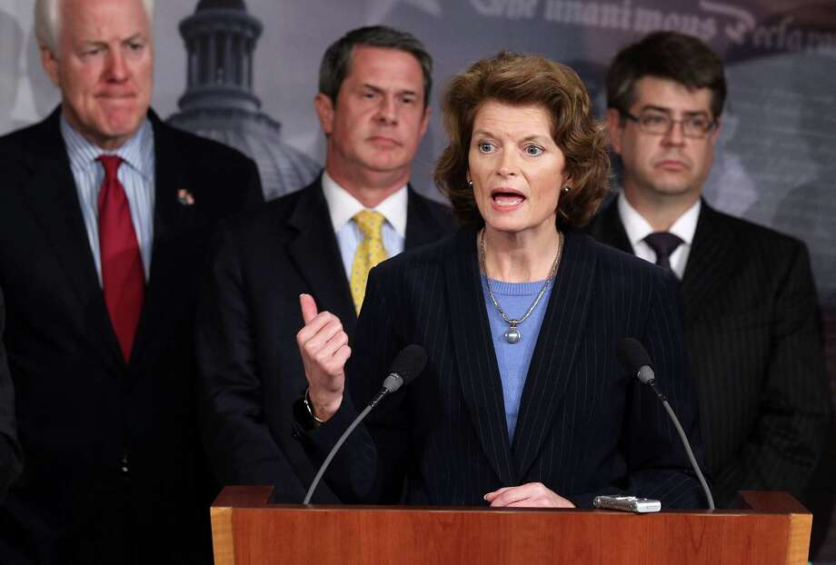 Sen. Lisa Murkowski, R-Ark., Sen. John Cornyn, R-Texas, David Vitter R-La., and Rep. Lee Terry, R-Neb., listen during a news conference March 22, 2012 on Capitol Hill in Washington, DC. Photo: Alex Wong, Getty Images / 2012 Getty Images