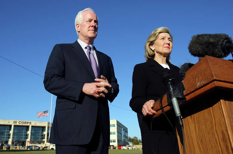 John Cornyn and Kay Bailey Hutchison speak during a press conference outside III Corps headquarters