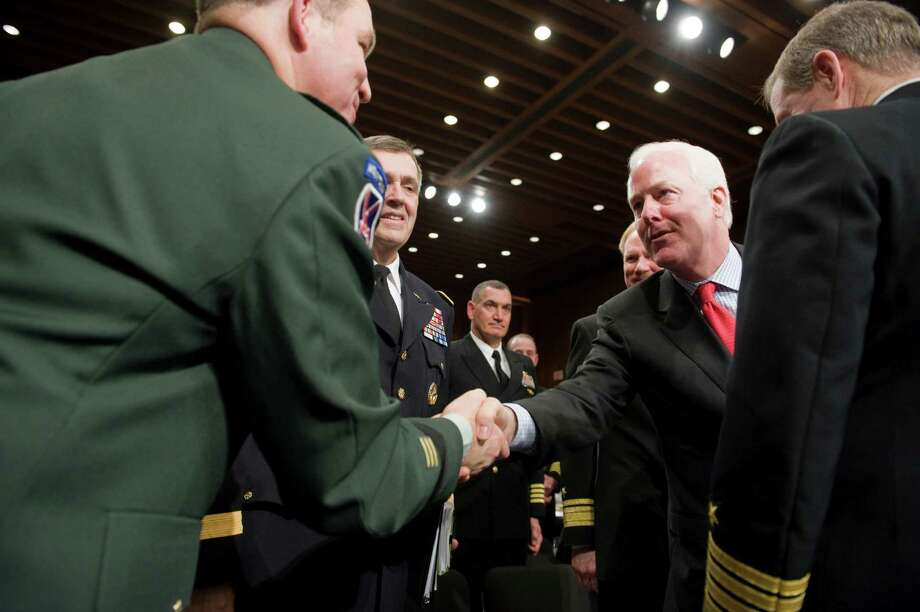 Senator John Cornyn greets US Army Lieutenant General Benjamin C. Freakley, Commanding General of the US Army Accessions Command, before a hearing on the incidence and prevention of military suicides by the Personnel Subcommittee of the Senate Armed Services Committee in Washington, March 18, 2009. Photo: Jonathan Ernst, For The Chronicle / Freelance