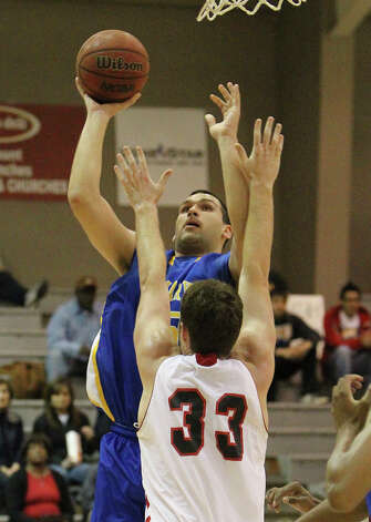 St. Mary's Kevin Kotzur (55) attempts a shot over Incarnate Word's Anthony Horton (33) during their game at UIW on Wednesday, Nov. 14, 2012. Photo: Kin Man Hui, San Antonio Express-News / ©2012 San Antonio Express-News