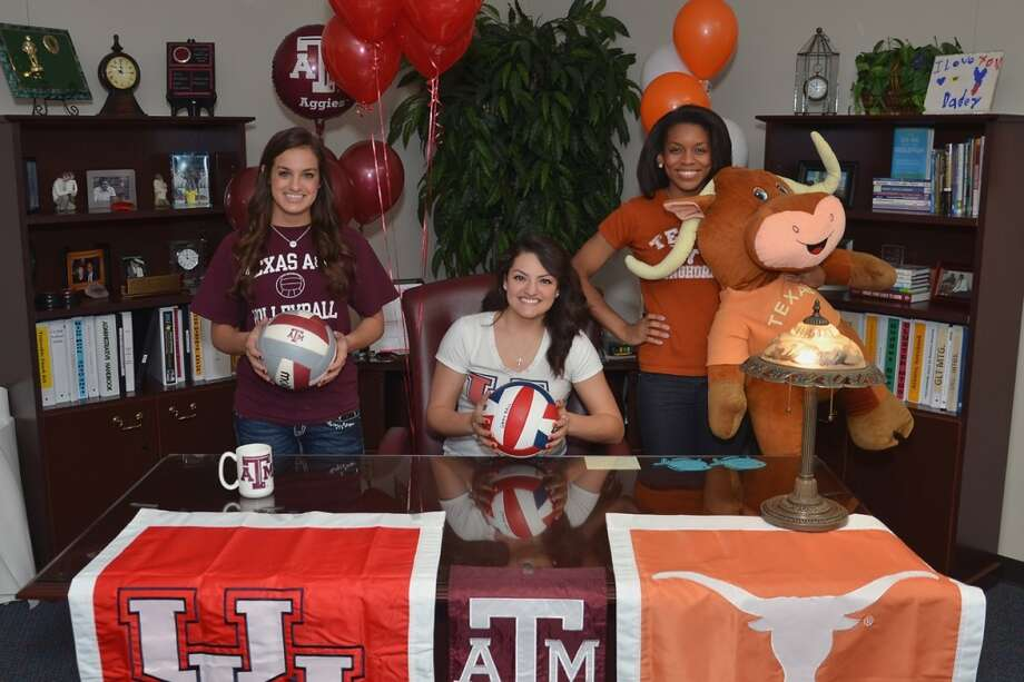 Cy-Wood Volleyball signings From left to right Victoria Arenas signs to Texas A&M University, Marisa Guzman signs to The University of Houston, and Chloe Collins signs to The University of Texas (Courtesy of Cy Fair Athletic Department )