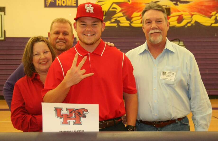 Kirby Peek of Jersey Village baseball team with family as he signs to become apart of the University