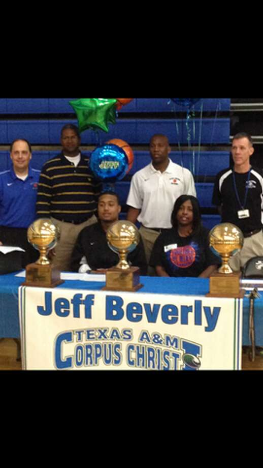 Jeff Beverly with family and coaches as he signs letter of intent (Courtesy of Clear Spring Athletic Department )