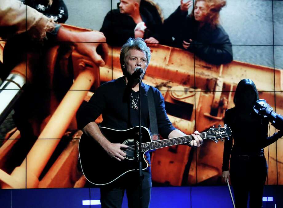 "FILE - In this Nov. 2, 2012, photo provided by NBC, Jon Bon Jovi performs in New York, during ""Hurricane Sandy: Coming Together,"" a concert hosted by NBC to raise money for victims of Superstorm Sandy. Bon Jovi, along with Paul McCartney, Bruce Springsteen & the E Street Band, Kanye West, Billy Joel, The Who and Alicia Keys will perform at another benefit concert, on Dec. 12, at Madison Square Garden in New York. Proceeds from the concert will go to the Robin Hood Relief Fund to help those affected by Sandy in New York, New Jersey and Connecticut. Sandy's assault more than two weeks ago created widespread damage and power outages throughout the area. (AP Photo/NBC, Heidi Gutman, file) Photo: Heidi Gutman"
