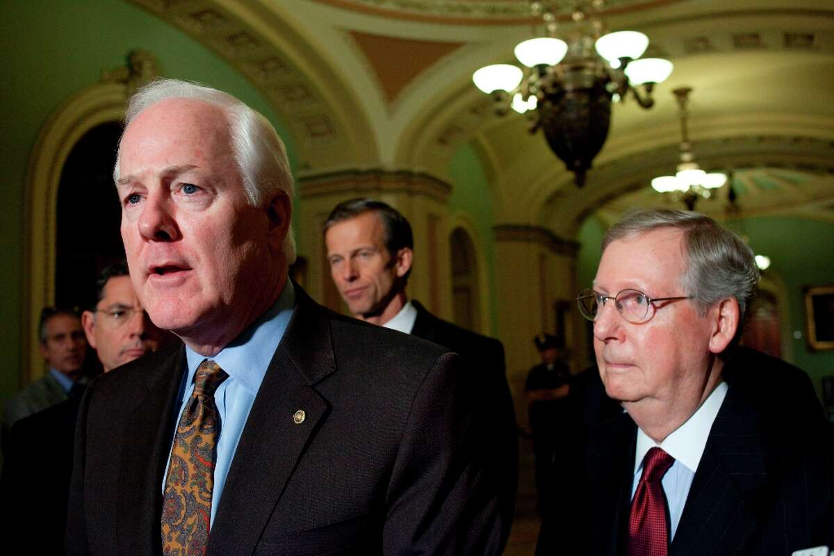 New Senate Minority whip John Cornyn of Texas, left, speaks during a news conference on Capitol Hill in Washington, Wednesday, Nov. 14, 2012. From left are, Cornyn, as Sen, John Barrasso, R-Wyo., John Thune, R-S.D., and Senate Minority Leader Mitch McConnell of Ky. (AP Photo/Harry Hamburg)