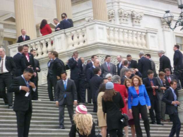 Joaquin Castro makes his way down the Capitol steps after taking a photo with fellow House freshmen.