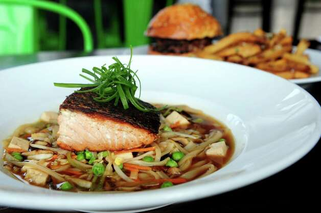 Salmon Noodle Bowl at The Chelsea in Fairfield, Conn. Thursday, Nov. 15, 2012.  Hot smoked fillet floating on shroom broth, rice noodles, tofu and shaved cabbage. Photo: Autumn Driscoll / Connecticut Post