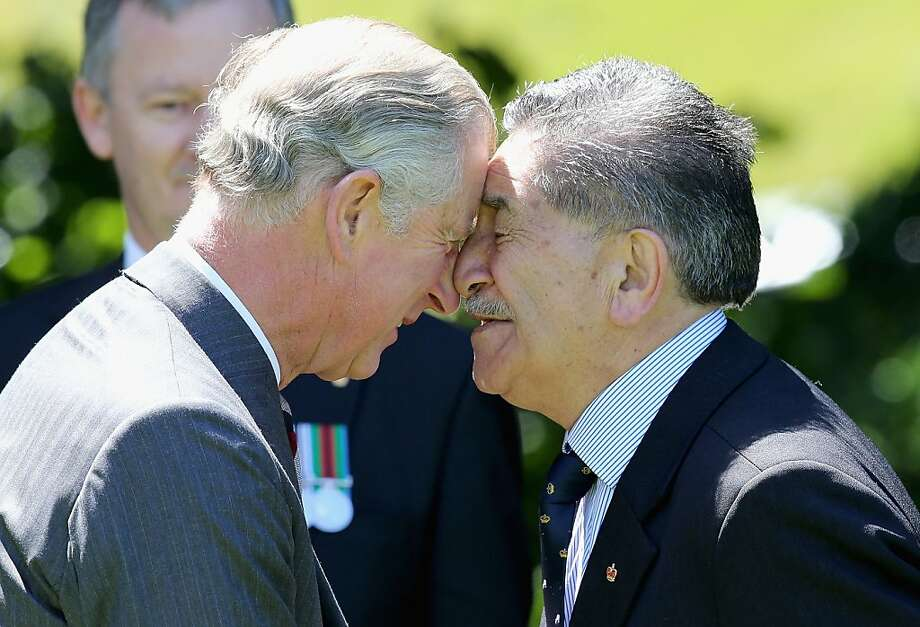 Pleased to meet you:Prince Charles greets senior parliament adviser Lewis Moeau in traditional hongi fashion - nose to nose and forehead to forehead - at the Government House in Wellington, New Zealand. The Maori greeting serves the same purpose as a formal handshake. Photo: Chris Jackson, Getty Images