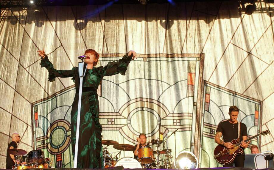"""If you're ever locked in a small space with Florence Welch's drummer, Chris Hayden, you'll have to be the calm one, because it seems he doesn't hold it together well in a non-life-threatening crisis. Welch's father offered to perform with the singer at a gig last week, after Hayden became locked in a backstage bathroom. Welch told The Scotsman newspaper, """"He got trapped in the loo. He was screaming. He got really freaked out. We could hear him trying to bash the door down, and they had to take the door off its hinges."""" Photo: Jack Plunkett, Associated Press / Invision"""