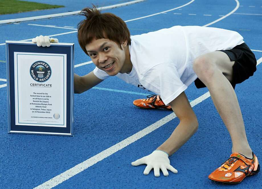 """All that work pays off:At Komazawa Olympic Park Stadium in Tokyo, Kenichi Ito - better known as the """"Monkey Man"""" - shows off his Guinness World Records certificate after setting a new mark for running 100 meters on all fours - 17.47 seconds. Ito, 30, has trained for nine years walking and running like a monkey. No doubt he could beat Usain Bolt on all fours. Photo: Koji Sasahara, Associated Press"""
