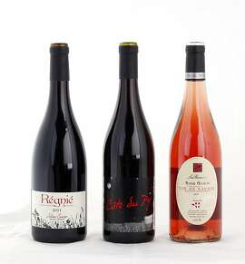 Left-right: 2011 Julien Sunier Regnie, 2011 Cote Su Py, 2011 Domaine Chignard Les Moriers Fleurie, 2011 Lapierre Raisins Gaulois, 2011 Les Rocailles Rose Gamay Vin de Savoie as seen in San Francisco, California, on Wednesday, November 14, 2012.