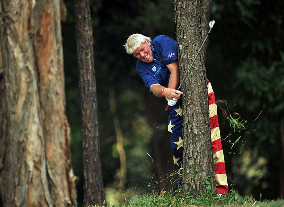 A difficult lie nearly gives John Daly a stroke at the UBS Hong Kong Open. Photo: Stuart Franklin, Getty Images