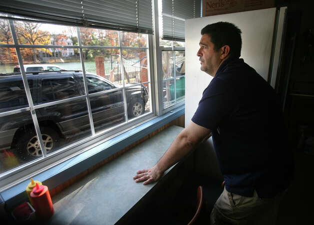 Jeff Arciola, owner of Jr.'s hot dog stand on Riverside Drive in Westport looks out his back window at the Saugatuck River on Thursday, November 15, 2012. Arciola's business was flooded with over two feet of water during Hurricane Sandy. Photo: Brian A. Pounds / Connecticut Post
