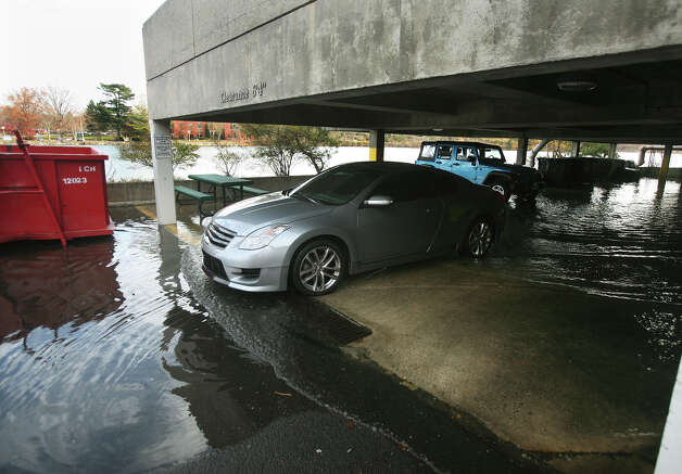 The lower level of a parking garage floods at high tide on Riverside Drive in Wesport on Thursday, November 15, 2012. During Hurricane Sandy the water reached the level of the overhead lighting. Photo: Brian A. Pounds / Connecticut Post