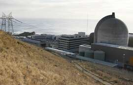 FILE - This Monday Nov. 3,2008 file photo shows one of Pacific Gas and Electric's Diablo Canyon Power Plant's nuclear reactors in Avila Beach on California's central coast. California coastal regulators were set to weigh in Wednesday, Nov. 14, 2012 on the utility's contentious plan to map offshore earthquakes faults near a nuclear power plant by blasting loud air cannons.  A commission staff report said the work would disturb some 7,000 marine mammals in the region. (AP Photo/Michael A. Mariant, File)