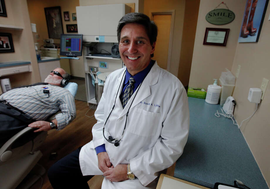 Dr. David Little of China Grove is one of the first dentists to use NuCalm, a non-narcotic system to calm dental patients before procedures. Little offered this procedure in 2008 and believes it to be an effective method to calm nervous patients. NuCalm uses a combination of non-narcotic calming tablet, music, light-reducing glasses and electrical stimulation to put a patient in a deeply relaxed state. Little believes this system allows him to be a more effective dentist in treating his patients needs. Kin Man Hui/kmhui@express-news.net Photo: KIN MAN HUI, SAN ANTONIO EXPRESS-NEWS / kmhui@express-news.net