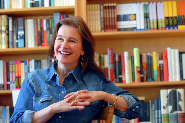 "FILE - This May 16, 2008 file photo shows author Louise Erdrich at her store BirchBark Books in Minneapolis. Erdrich, 58, won a National Book Award Wednesday, Nov. 14, 2012, for her story, ""The Round House"" the second of a planned trilogy, about an Ojibwe boy and his quest to avenge his mother's rape. Erdrich, who's part Ojibwe, spoke in her tribal tongue and then switched to English as she dedicated her fiction award to ""the grace and endurance of native people."" (AP Photo/Dawn Villella, file) Photo: Dawn Villella"