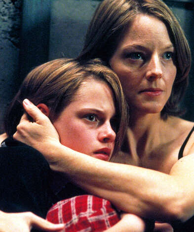 A mother and daughter (Jodie Foster, right, and Kristen Stewart) hide from thieves in a secret room of their new house in the suspense movie ''Panic Room'' Thursday on HBO.