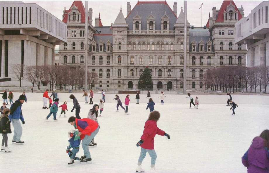 TIMES UNION STAFF PHOTO BY LUANNE M. FERRIS --SATURDAY, JANUARY 4, 1997 -- ALBANY, THE EMPIRE STATE PLAZA, ICE SKATING RINK WITH THE NEW YORK STATE CAPITAL IN THE BACKROUND.  ENTERPRISE.  01/05/97 Photo: LUANNE M. FERRIS / ALBANY TIMES UNION