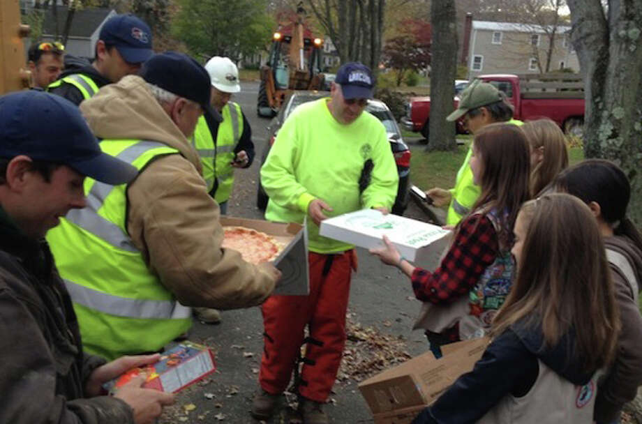 Members of Girl Scout Troop 33038 deliver pizza and cookies to Department of Public Works employees during cleanup operations in the wake of Hurricane Sandy.  Fairfield CT 11/12/12 Photo: Contributed Photo / Fairfield Citizen contributed