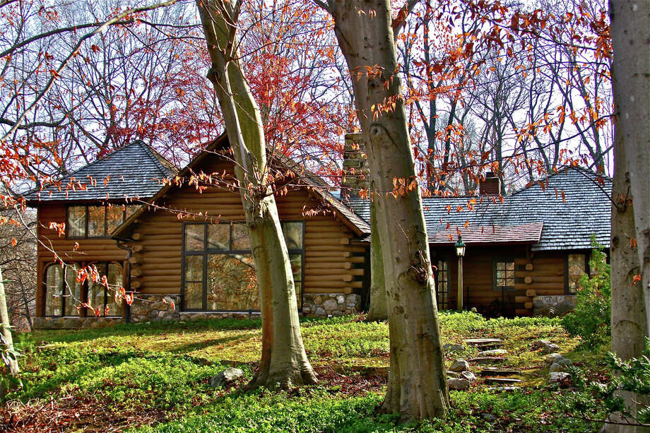This riverfront log lodge is one of five houses to be shown during the Westport Historical Society's Holiday House Tour on Sunday, Dec. 2. Photo: Contributed Photo