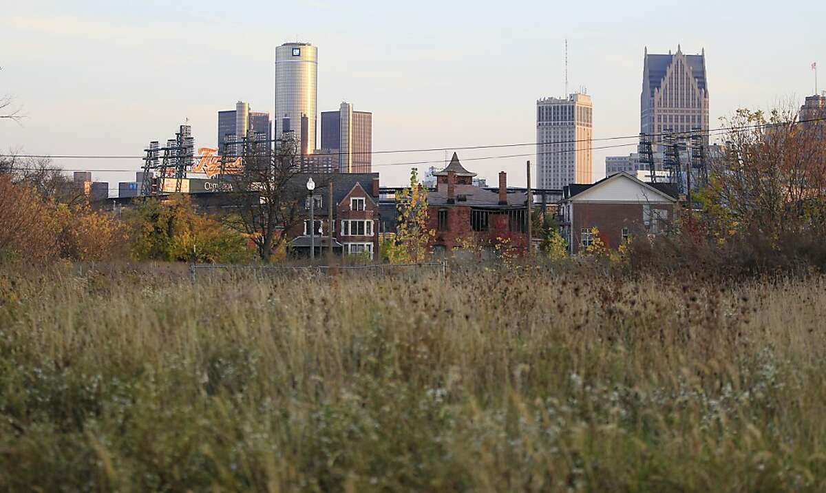 This Oct. 24, 2012, photo shows an empty field north of Detroit's downtown. When baseball's World Series returns to Detroit this weekend for Game 3, television viewers will see vibrant crowds and skyline shots of the city. Yet beyond the hot dogs and home runs, Detroit is struggling to cross home plate. (AP Photo/Carlos Osorio)