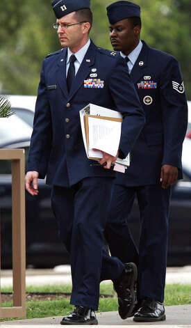 U.S. Air Force 321st Training Squadron Staff Sgt. Donald Davis, right, arrives for a hearing at Lackland Air Force Base, Thursday, Nov. 15, 2012. Davis is facing charges of aggravated sexual contact, assault and battery on one female trainee. Photo: Jerry Lara, San Antonio Express-News / © 2012 San Antonio Express-News